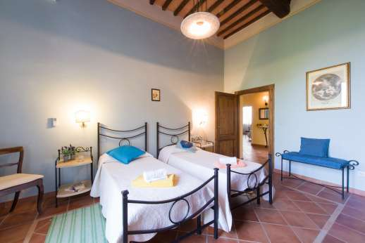 Villa Astori - Air conditioned twin bedroom with en suite bathroom.