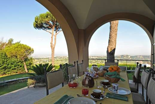 Villa delle Lance - Loggia furnished for dining al fresco.