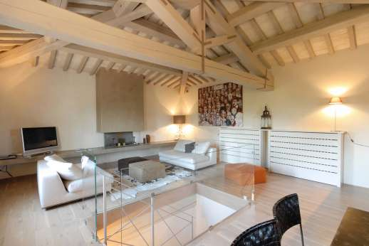 Villa Di Masseto - The Tower, up 16 metal steps to a large sitting area with a flat-screen TV. Kitchenette.