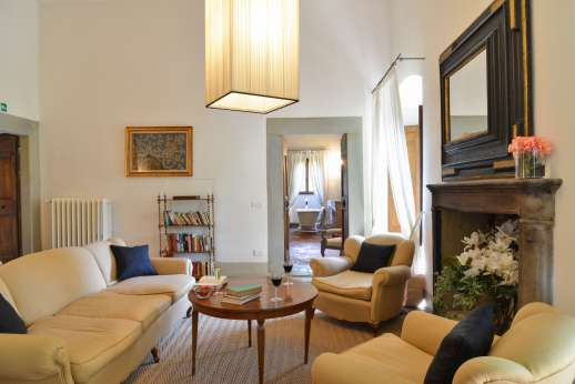 Villa Di Masseto - First floor up 21 stone steps to a sitting room with fireplace.