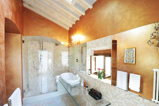 Villa Di Masseto - One of the stylish bathrooms with shower and elegantly mosaicked walls.