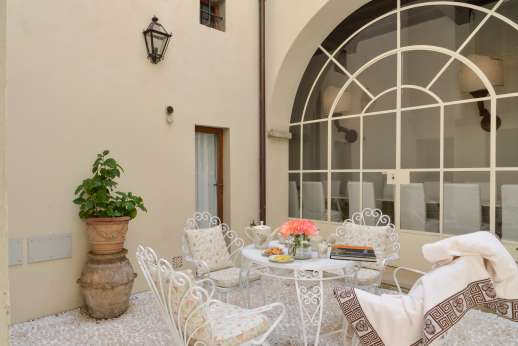 Weddings at Villa Di Masseto - The inner courtyard looking through to the dining area