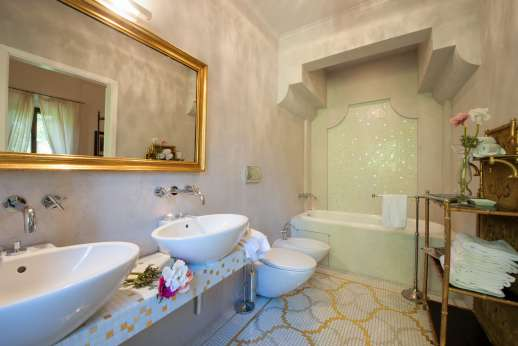 Weddings at Villa Di Masseto - En suite bathroom with two sinks.