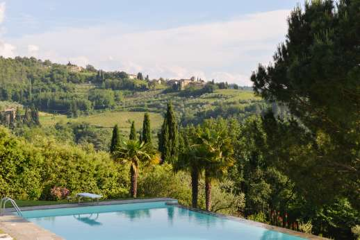 Villa di Pile - The infinity pool is set below the villa within the gated garden surrounded by lush green lawns.