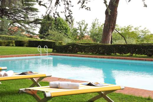 Villa Lungomonte - The pool is set about 50m/yards from the house across level lawns.