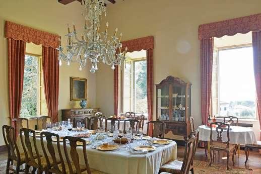 Villa Lungomonte - Elegant dining inside.