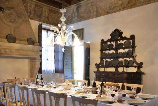 Villa Zambonina - The dining room with its elegant and characterful furniture leads out to the dining loggia.