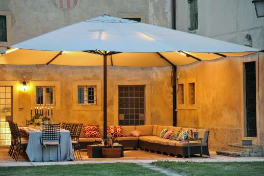 Weddings at Villa Zambonina - Outdorre seating and dining area with outdoor lighting