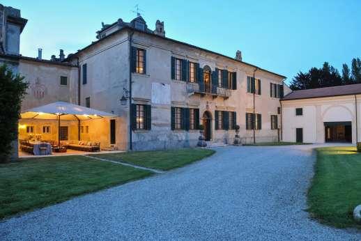 Weddings at Villa Zambonina - Villa and outdoor seating lit for evening times