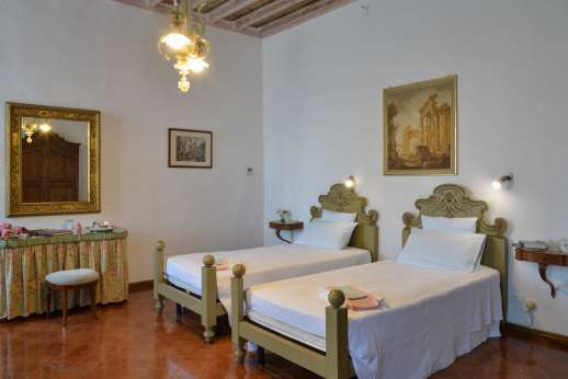Weddings at Villa Zambonina - Air conditioned twin bedroom that can be converted to a double with en suite on the first floor.
