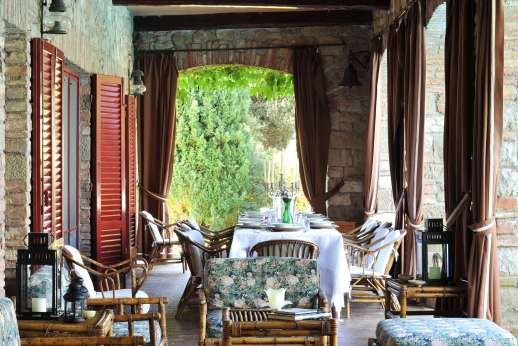 Visentium - The loggia furnished for dining and relaxing.