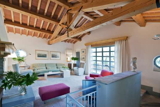 Villa La Leccina Casamora - La Leccina,  the villa is characterized by its pale terracotta floors, natural wood-beamed ceilings and a multitude of French doors that allow the rooms to fill with the unique Tuscan light.