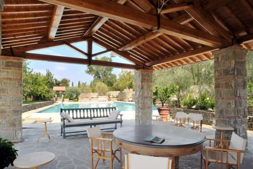 Villa La Leccina Casamora - Poolside, the shaded loggia with a sitting area.
