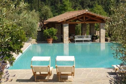 Villa La Leccina Casamora - Pool terrace with a shaded loggia.