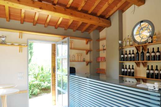 Villa La Leccina Casamora - Poolside loggia with seating area, a self-service bar and changing rooms.