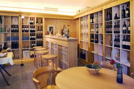Villa La Leccina Casamora - The enoteca is one of the most appealing rooms in the borgo, not least because its walls are lined with a mouth-watering selection of the finest Tuscan wines and grappas.