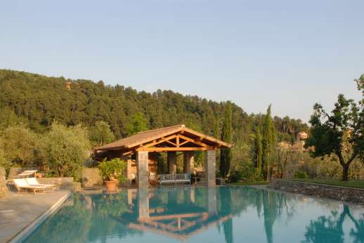 Villa La Nocciolina Casamora - The poolside loggia with seating area perfect for reading and relaxing.