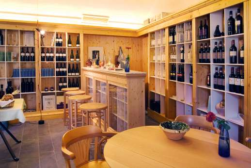 Villa La Nocciolina Casamora - The enoteca is one of the most appealing rooms in the borgo, not least because its walls are lined with a mouth-watering selection of the finest Tuscan wines and grappas.