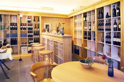 Il Noce Casamora - The enoteca is one of the most appealing rooms in the borgo, not least because its walls are lined with a mouth-watering selection of the finest Tuscan wines and grappas.