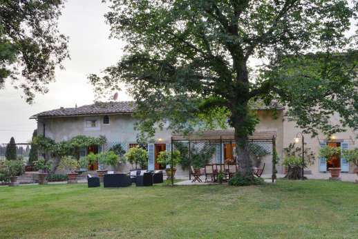 The Estate of Casa Vecchia - The age old tree gives shade to the dining area in the large well kept garden.