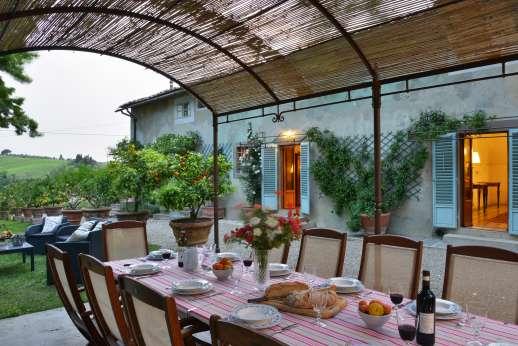 The Estate of Casa Vecchia - Al fresco dining in the pretty, informal garden.