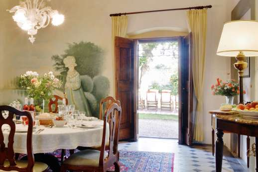 The Estate of Casa Vecchia - Dining room which leads out to the garden.