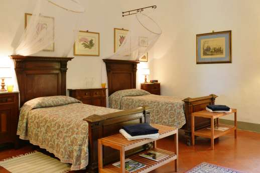 The Estate of Casa Vecchia - Twin bedroom with direct access to the garden with en suite bathroom.