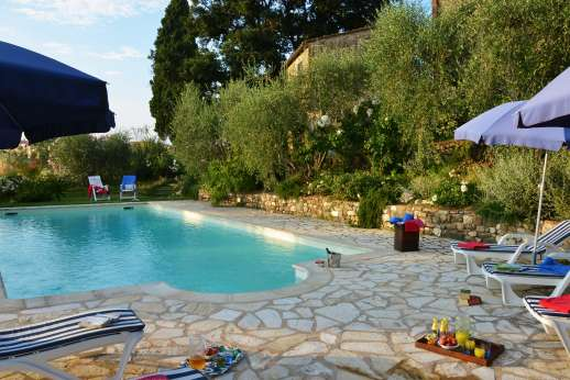 The Estate of Casa Vecchia - The swimming pool has been strategically located on a lawned terrace below the house for the best views of all.