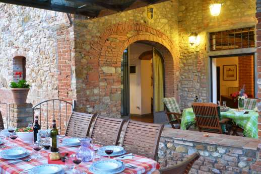 The Estate of Casa Vecchia - Covered dining loggia and terrace leading out from the ground floor kitchen/sitting room.