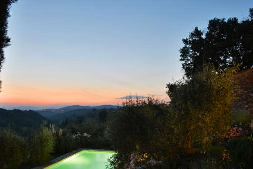 The Estate of Casa Vecchia - The fully lit pool can be enjoyed in the evening while admiring the Tuscan rolling hills.
