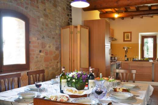 The Estate of Casa Vecchia - Open plan kitchen/dining room leading out to the terace.