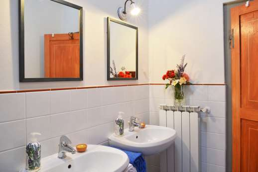 The Estate of Casa Vecchia - Double sink en suite bathroom with bath.