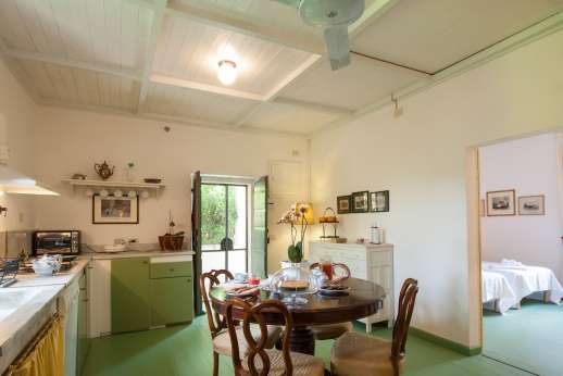 Villa le Cipressae - Second floor kitchenette and dining area with joining bedroom
