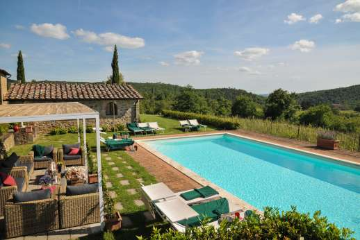 Borgo Gerlino - The refreshing pool with sample seating and amazing views