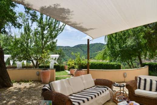 Villa Albizi - Relaxing outside seating area with paved area by the pool in the background