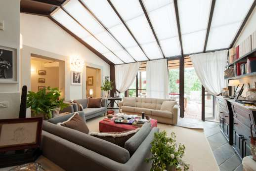 Villa Albizi - The ground floor sitting room with access to the external dining area