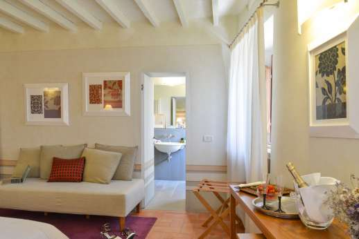 Villa Albizi - Another view of the bedroom with sofa leading through to the ensuite