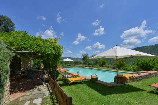 Podere Uccella - The large swimming pool, 18 x 7m/59 x 23 feet is set within a fenced off area with a loggia