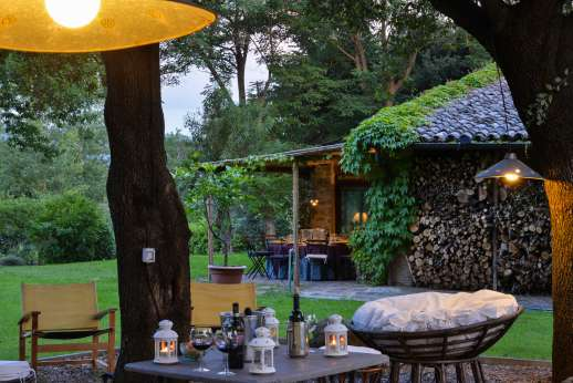 Podere Uccella - Seating area lit at night to enjoy your evening outdoors