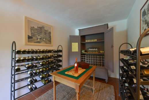 Podere Uccella - Cantina with a collection of wines for sale