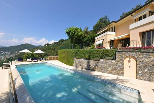 Bellaria - On a lower terrace, 20 meters from the main house. The private heated, infinity-edge and gated swimming pool, 15 x 5 meters/50 x 16 feet