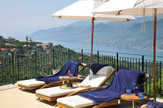Bellaria - Pool area is furnished with sun loungers and umbrellas for shade.