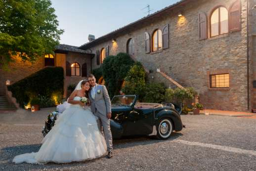 Weddings at Villa Ostignano - The happy couple in the villa courtyard