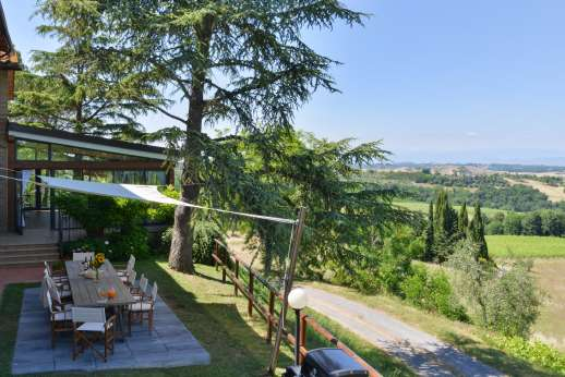 Weddings at Villa Ostignano - Kitchen leads out to shaded al fresco dining area in the garden.