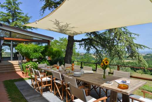 Weddings at Villa Ostignano - Shaded al fresco dining area in the garden.