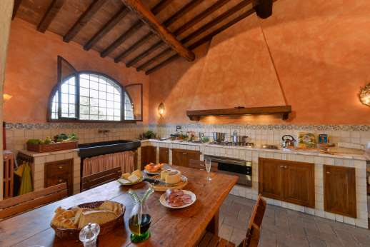 Poggio Ai Grilli -  Large fully equipped kitchen with direct access to the al fresco dining area