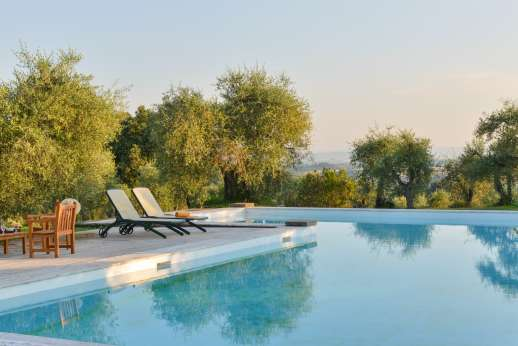 Poggio di Artemis - Relax on the sun lounges or seating areas by the pool