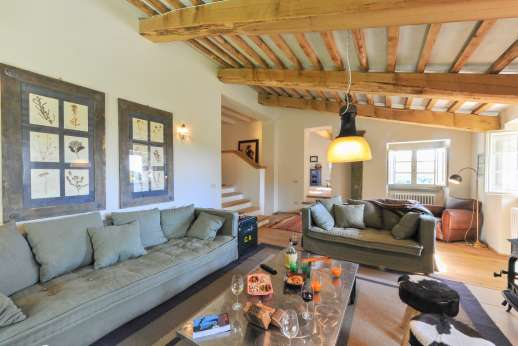 La Palazza Nel Cielo - Upper ground floor sitting room with TV, two sofas, wood stove and access to the back garden.