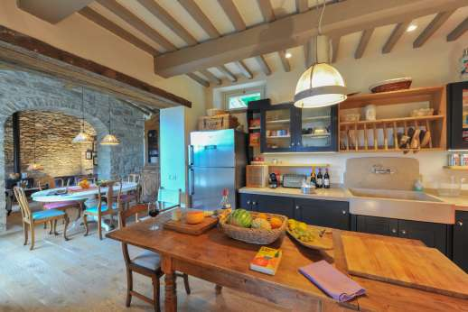 La Palazza Nel Cielo - Kitchen and work table leading though to the informal dining area and sitting room