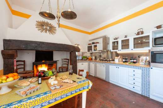 Tizzano - Well equipped kitchen with original fireplace on the ground floor.